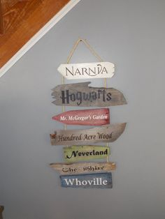 This custom made to order wall hanging consists of 7 hand painted reclaimed wood signs. Featuring classic story book titles and make believe