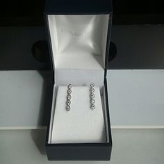 Sterling silver earrings Sterling silver earrings in box,  each has 5 stones presumably cz's and detailing. Really lovely. Sigal Jewelry Earrings