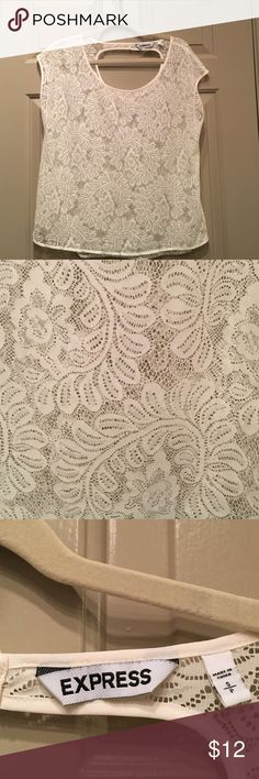 Express White Lace Top, Size Small Express White Lace Top. Sheer Lace. Cutout on back. Excellent condition. Size small, fits slightly flowy. Pair any color tank top underneath for a stylish look! Express Tops Blouses