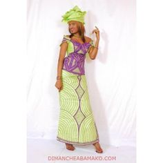 Dakaroise (from Dakar, Senegal) complet (a complet consists of the wrap-skirt, the top, and a scarf).  Dimanche a Bamako has a fairly large selection of not-so-high-quality photos of complets for purchase.  A jumping-off-point for coming up with a design...