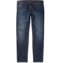 There's no disputing that washed blue jeans are a style perennial and an indispensable component of any man's wardrobe. This pair from <a href='http://www.mrporter.com/mens/Designers/Hugo_Boss'>Hugo Boss</a> is as ageless as they come. Made from soft denim blended with the perfect amount of stretch, they have a classic five-pocket construction and saffron stitching. The slim cut makes them particularly adaptable - take your cue fr...