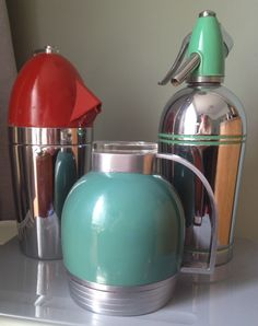 """Soda syphons and vacuum flask. Designs: L to R Norman Bel Geddes, Henry Dreyfuss and anonymous - """"Streamline"""" model sparklets soda syphon circa 1938."""