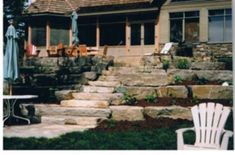 Garden beds in each level soften up the large stones used here. Picture compliments of www.ogslandscape.ca