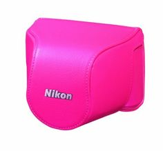 Nikon CB-N2000SD Pink Leather Body Case Set by Nikon. $37.98. The Nikon Leather Body Case Set for Nikon 1 J1 Camera with 10-30mm Lens (Pink) is a set of 2 protective leather cases designed specifically for the Nikon 1 J1 mirrorless digital camera with a 1 Nikkor 10-30 mm Zoom Lens attached. The J1 is a compact, interchangeable lens camera. It slides into the smaller of these 2 leather cases like a cup sliding into a cup-holder. This case only covers the bottom, sides an...
