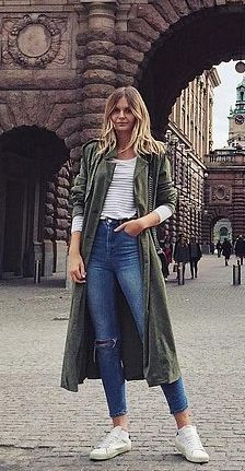 A Military Jacket With Jeans and Sneakers