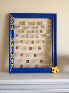 Take an old frame add some paint and embellishments to create a custom belt loop display! Take an old frame add some paint and embellishments to create a custom belt loop display! Cub Scout Law, Cub Scouts Wolf, Tiger Scouts, Scout Mom, Girl Scouts, Cub Scout Skits, Scout Games, Cub Scout Activities, Cub Scout Badges