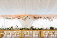 Tent Wedding | Long low rustic hanging branches - for a slight rustic touch. On Style Me Pretty: http://www.StyleMePretty.com/2014/02/11/rustic-elegance-in-beaver-creek-at-red-sky-ranch/ Photography: Erin Hearts Court
