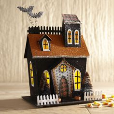 More sparkly than spooky, our handcrafted, pre-lit bungalow boasts fun, patterned decor and a few high-flying bats. Set it on your entryway table, mantel or dining room table and wait for it to be greeted with Halloween smiles and giggles.