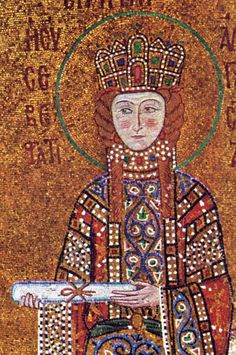 Mosaic of wealthy woman showing her long sleeved tunic and her hat like crown full of jewels and pearls. It also shows her pendants of pearls.
