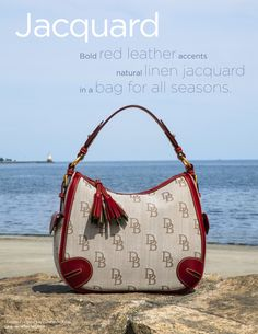 Natural linen and red leather... Dooney & Bourke's Signature Jacquard