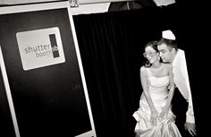 great picture of a couple using the Shutterbooth #photobooth at their wedding!