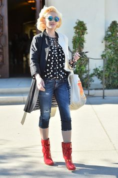Polka dot top, jacket, cuffed jeans, red shoes/heels, curled hair.