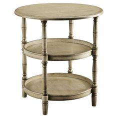 Three-tiered end table with turned legs.     Product: End table      Construction material: Wood  Color: