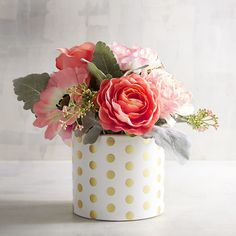 If ever there was a happy arrangement, this is it. Big and bright faux blooms. Polka-dot pot. All handcrafted to bring a smile to someone's face, whether that's you or a friend.
