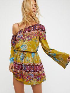 Modern Nomad Mini Dress | One shoulder mini dress featuring a boho-inspired print and an effortless drawstring waist.    * Lined * Hidden side pocket details   * Removable strap option for easy wear