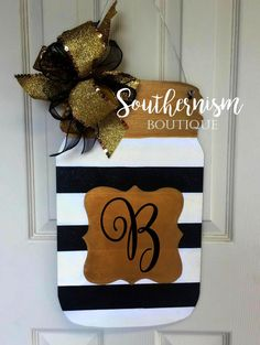 Mason Jar Wooden Door Hanger  Welcome your guest with this flashy bright Mason Jar featuring gold accents, glitter, and your initial!