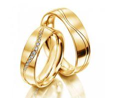 CALIE - Duo d'alliances en or jaune 18 cts et diamants. www.1001carats.fr