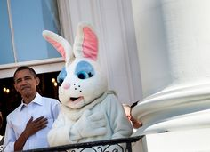 President Barack Obama and the  Easter bunny listen to the US National Anthem.