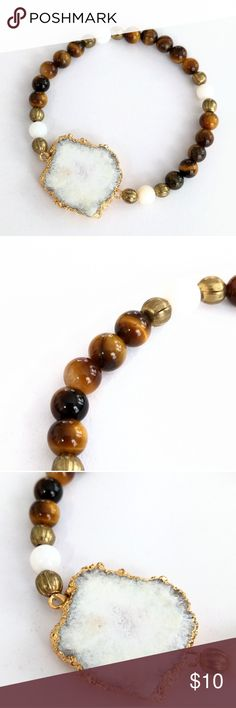 """Gold-plated solar quartz and tiger's eye bracelet Natural beauty meets a cool, free-spirited design in this comfy-chic treasure!  A gold-plated genuine matte solar quartz stone takes center stage among tiger's eye beads.  Vintage golden and white shell bead accents complete the look for a unique piece ideal for stacking and perfect on its own!  Bracelet stretches to fit most wrists.    PRICE IS FIRM and extremely reasonable, but click """"add to bundle"""" to save 10% on your purchase of 2+ items…"""