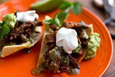 NYT Cooking: These are fairly high-brow nachos, topped with a mountain of soft, spicy, chile-braised short ribs run through with rivers of molten cheese, above hillocks of guacamole; soft mounds of salsa; creamy pools of sour cream. They're a little more halftime show than Super Bowl, and that's okay: The showmanship here is matched by the flavor.