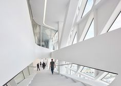 The alternating transparent and opaque panels used in Zaha Hadid Architect's Antwerp's Port building provide ample daylight, shade and views out to the Scheldt river, city and port for workers.
