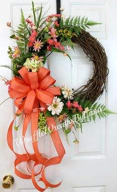 This Dark Coral Grapevine Wreath is a beautiful color for the spring and summer and would be the perfect accent for your front door to welcome family and friends into your home! This could be used starting now and going all the way to the end of the summer. It would also be a great gift for Mothers Day, which is right around the corner. This wreath is made on a grapevine base, and Ive added artificial flowers and greenery to give it a wildflower appearance, which is my favorite! There is…