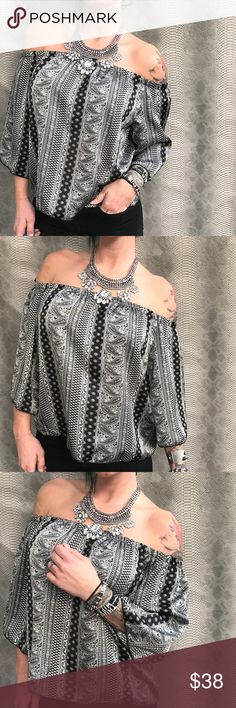 Paisley Boho off shoulder silky top Bohemian paisley off the shoulder blouse   NEW WITH TAGS .   100% polyester    The perfect off the shoulder blouse for the  bohemian look . Silky fabric and a lightly ruffled elastic shoulder .   Use the OFFER BUTTON • bundle for 10% off   🤗 please no drama ladies lets be nice 🤗  • 5 star rating  • 400+ sales  • smoke free home  • 100% authentic  |💀| www.thethugwife.com |💀|   N O   TRADES Tops Blouses