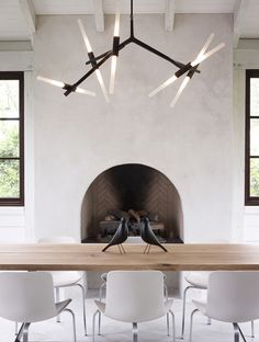 Lindsey Adelman chandelier dining room white fireplace wood by Barbard Hill photo by Gregory Miller