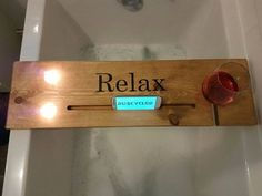 This is the perfect Gift! Ruscycled Relaxation Station is a beautiful handmade bath caddy to help your loved one relax and unwind with candles, wine and even smartphone/tablet. Each station has 2 holes for 2 tea light candles (included)! . A groove for a smartphone or tablet. Also a groove in which to place a glass of wine! There is a rail fixed underneath the board at approx 11cm to prevent the board from slipping into the bath. Can be left untreated, natural in colour (will be sealed ...