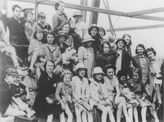 Group portrait of German Jewish refugee children on the deck of the SS Batory as the ship arrives in Melbourne.