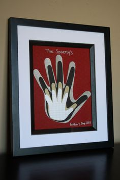 Cutouts of the Family's Hands and Framed. What a wonderful idea!!  Would be a Great Mother's Day or Father's Day Present!!