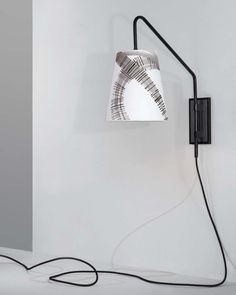 The Urban Electric Company's #Audley sconce features a gracefully angled swing arm and a cleverly concealed 3-way touch sensor. Shown here with our new Porte Berger shade by Robert Escalera. #uecoquickship #rexueco #uecothrowingshade #itsallaboutthesconce #urbanelectric #abstractart #lampshade #blackandwhite #sconces #sconce #lightingideas #lighting #lightingdesign #customshades