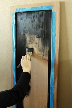 really easy DIY chalkboard: I did this with an old painting I bought at a yard sale, I liked the shape and the decorative frame so I just painted over the painting with chalkboard paint!