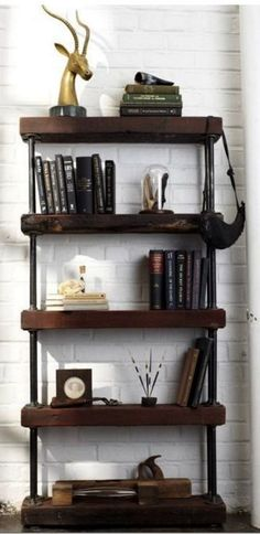 Rustic industrial bookcase made from galvanized pipe and reclaimed wood.