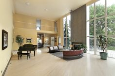 This modern home has a very open floor plan. The pale hardwood flooring pops against the dark furniture and the black grand piano. Living Room Styles, Small Living Room Design, Simple Living Room, Spacious Living Room, Beautiful Living Rooms, Living Room Colors, Small Living Rooms, Living Room Modern, Living Room Interior