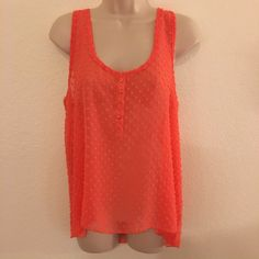 NWOT Chiffon Loose Top Never been worn chiffon loose top with little round textures in coral. 100% polyester. Tops