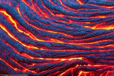 flowing lava, Kilauea Volcano near Kalapana in Hawaii (Thorsten Scheuermann).   http://www.georgianewsday.com/news/regional/293109-from-boiling-lava-and-ice-bubbles-to-painted-hills-and-blue-desert-mud-the-spectacular-images-that-celebrate-the-beauty-of-nature.html#sthash.hDdobupB.dpuf