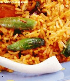 This traditional Maharashtrian rice is an amazing combination of spicy flavours and mouth-watering textures. When served with low fat curds,  or raita, it makes a complete meal in itself. Instead of brinjals and tendli, you can choose vegetables that are handy and whip up an easy nutritious meal in a jiffy.