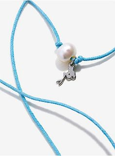 "<div>Make this adorable bracelet part of your world. Featuring an Ariel charm and a freshwater pearl, it's the perfect addition to your everyday wear who's-its and what's-its. </div><div><ul><li style=""list-style-position: inside !important; list-style-type: disc !important"">14 1/2""</li><li style=""list-style-position: inside !important; list-style-type: disc !important"">Semi-precious stones</li><li style=""list-style-position: inside !important; list-style-type: disc !important"">Imported..."