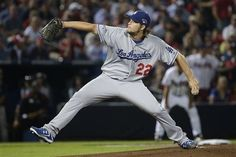 Los Angeles Dodgers starting pitcher Clayton Kershaw works in the 2nd inning against the Atlanta Braves during Game 1 of the National League Division Series, Thursday, Oct. 3, 2013, in Atlanta. (AP Photo/John Bazemore)