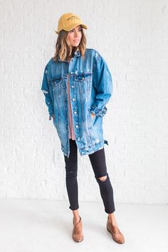DETAILS: - Classic oversized denim jacket with distressed detailing - Model is wearing a small