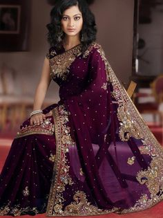 """Buy Wine Faux Georgette Saree with Blouse online, work: Embroidered, color: Wine, usage: Wedding, category: Sarees, fabric: Georgette, price: <span class=""""Geosymbol"""">`</span>10079.20, item code: SLSSK4800, gender: women, brand: Utsav"""