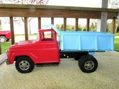 Vintage pressed steel structo hydraulic dual wheel dump truck