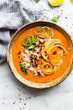 Soup season is so close, I can taste it! CREAMY ZANZIBAR CARROT-TOMATO SOUP! An African Inspired vegan bisque made in 30 minutes. Nourishing, flavorful, simply delicious
