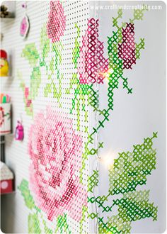 A cross stitch peg board (tutorial) - by Helena Schaeder Söderberg of Craft & Creativity, a Swedish craft blog. I might use a kurbits pattern instead, a typical ornamental design in Swedish folk art