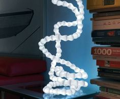 Abyss Table Lamp  Add a geeky touch of style to any room with the abyss table lamp. The Italian made lamp features a bold modular structure that allows you to bend and fold the 43 lamp into whatever abstract masterpiece you find aesthetically pleasing for that given day.  $350.00  Check It Out  Awesome Sht You Can Buy