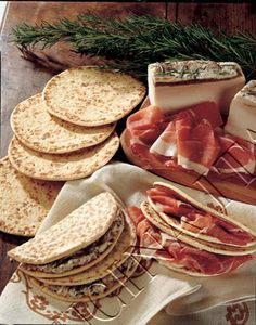 Piadina Romagnola : thin Italian flatbread, typically prepared in the Romagna region (Forlì-Cesena, Ravenna and Rimini). It is usually made with white flour, lard (or olive oil), salt and water. The dough was traditionally cooked on a terracotta dish (called teggia in the Romagnolo dialect), although nowadays flat pans or electric griddles are commonly used. The Piadina has been inserted into the list of the traditional regional food products of Italy of the Emilia-Romagna Region.