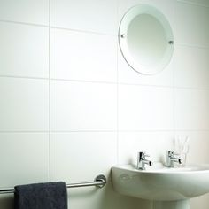 WICKES WHITE SATIN CERAMIC WALL TILE 250X400MM Product Code: 214538  Tone Variation: Low Water Absorption Rating (W.A.): 17.01 Sealing Required: No Sourced From: UK Pack Coverage: 1 m² Colour: White Material: Ceramic Pack Quantity: 10 Pk. Length: 248 mm Width: 398 mm Usage: Bathroom-Kitchen Finish: Satin Thickness: 8.25 mm Chemical Resistant: GLA+GHA Brand Name: Wickes