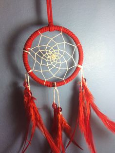 Red suede dream catcher with red feathers, white web and glass bead finish 7cm diameter dreamcatcher hand made on Etsy, £4.59