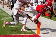 Kendal Thompson dives for a touchdown against Fresno State. (Trent Nelson     The Salt Lake Tribune)